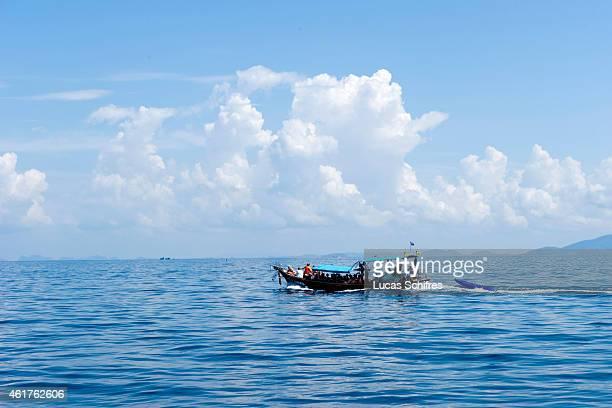 A boat drives near Ko Phi Phi islands on December 15 2010 in the Adaman Sea Krabi province Thailand