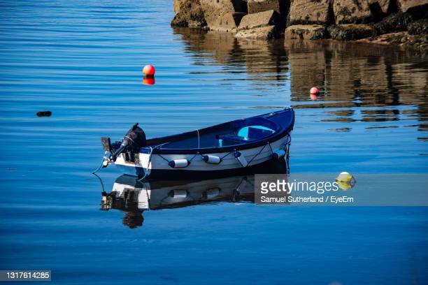 boat floating on lake - passenger craft stock pictures, royalty-free photos & images