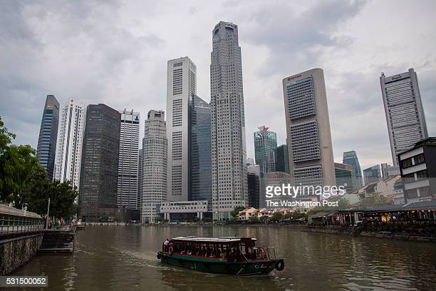 A boat floats along Marina Bay after a storm passes in the downtown core district in Singapore on Wednesday May 11 2016