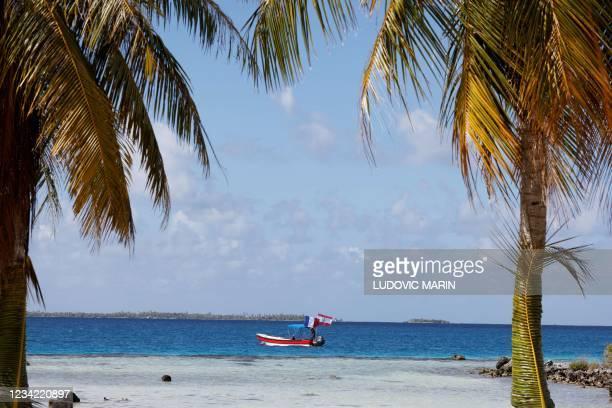 Boat floats on Manihi atoll, in the Tuamotu Archipelago, French Polynesia on July 26, 2021.