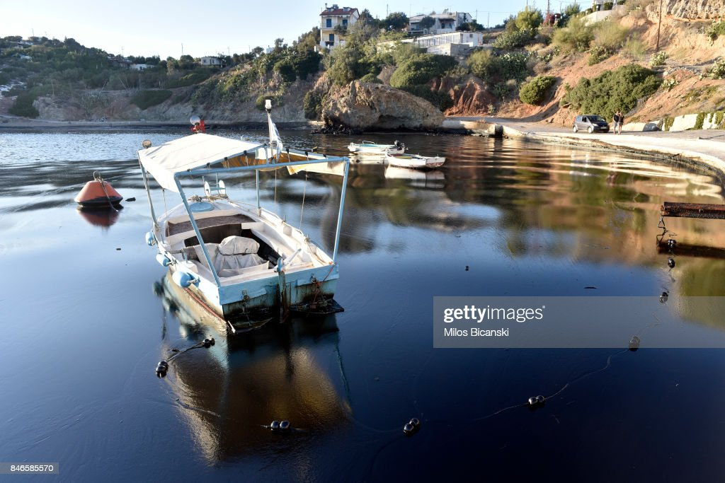 A boat floats on polluted water on the coast of Salamis Island on September 13, 2017 in Salamis, Greece. The small tanker 'Agia Zoni II' sank on September 10, whilst anchored off the coast of Salamis, near Greece's main port of Piraeus. It was carrying a cargo of 2,200 tons of fuel oil and 370 tons of marine gas oil. Salamis Island has suffered heavy pollution as a result in what has been called a 'major environmental disaster' by officials.
