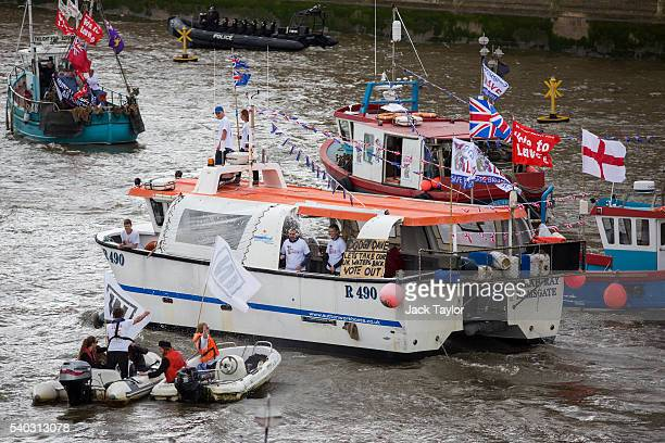 A boat from the 'Fishing for Leave' campaign group sprays boats from the 'In' campaign with water during a flotilla along the Thames River on June 15...