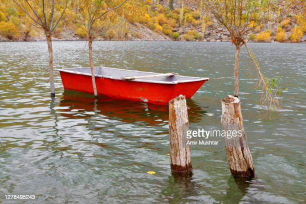 boat in a lake in autumn season. - skardu stock pictures, royalty-free photos & images