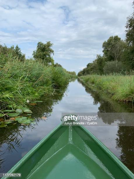 boat in canal against sky - overijssel stock pictures, royalty-free photos & images