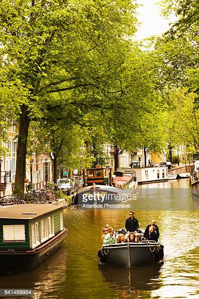 Boat in Raamgracht canal, Amsterdam, Netherlands