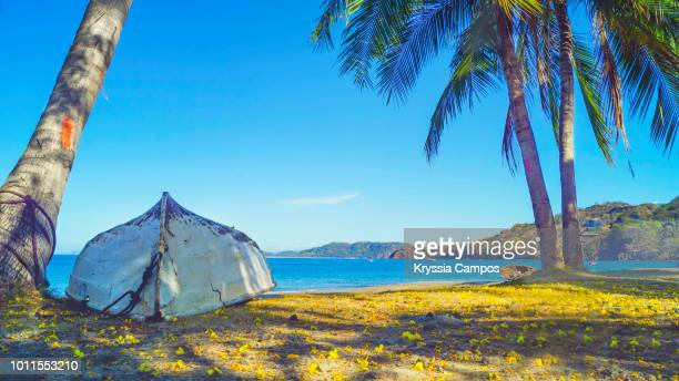 boat in sand at playa hermosa, guanacaste - costa rica - guanacaste stock pictures, royalty-free photos & images
