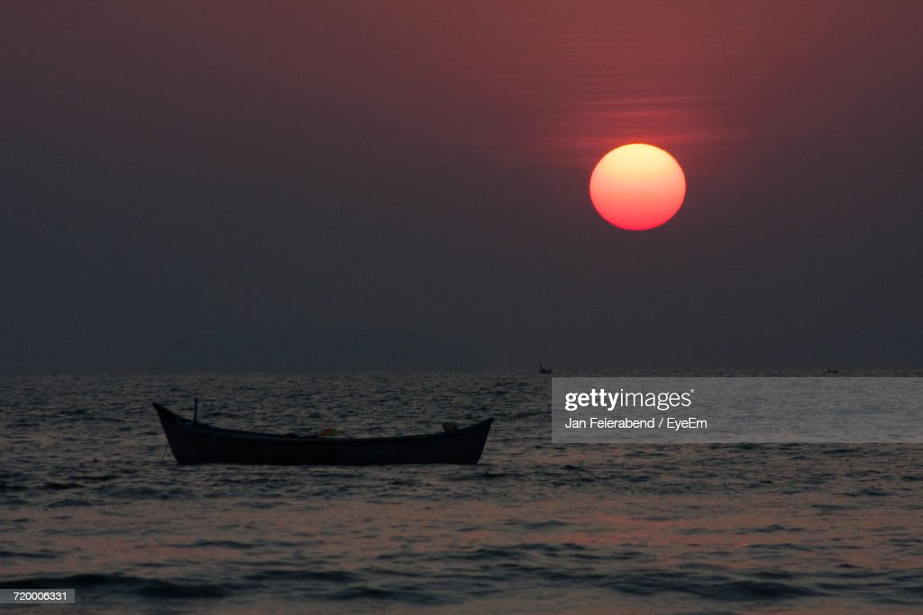 Boat In Sea At Sunset : Stock Photo