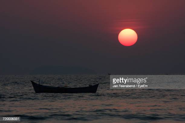 Boat In Sea At Sunset
