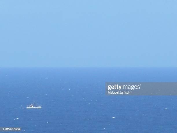 a boat in the blue ocean - 旅客船 ストックフォトと画像