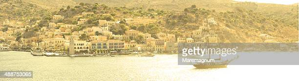 boat in the city harbour - symi stock photos and pictures