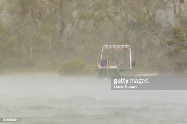 boat in the rain - lianne loach stock pictures, royalty-free photos & images