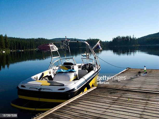boat in the water. - waterskiing stock photos and pictures