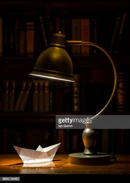boat in water with lamp - ian gwinn stock photos and pictures