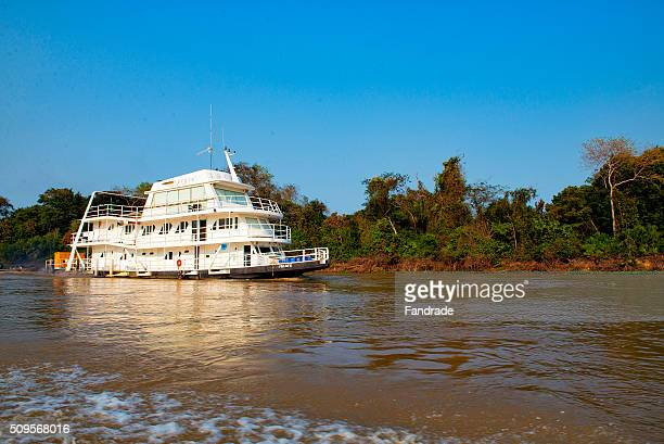 boat in wetland brazil - cuiaba river stock pictures, royalty-free photos & images