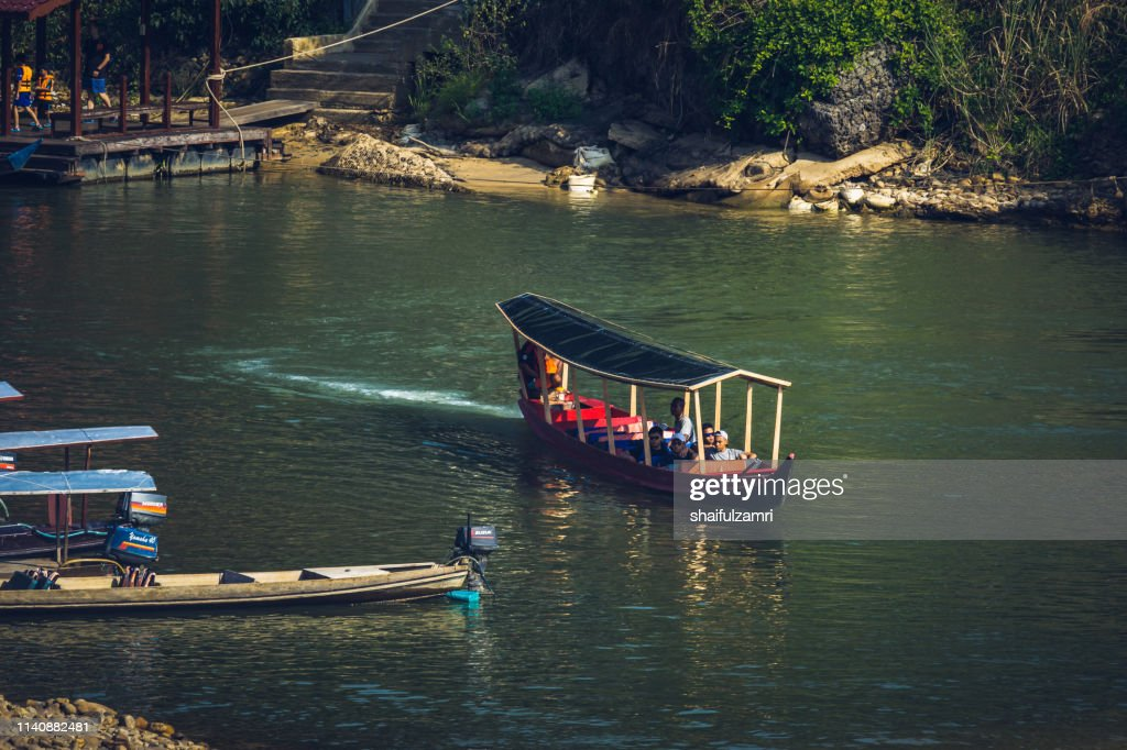 Boat is a main transportation in tropical rain forest landscape at Taman Negara, Pahang, Malaysia. : Stock Photo