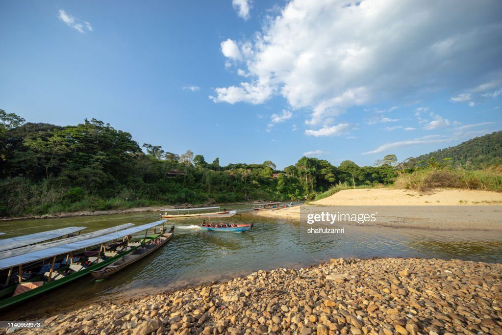 Boat is a main transportation in tropical rain forest landscape at Taman Negara, Pahang, Malaysia. : Stock Photo
