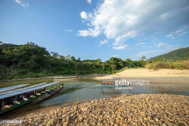 Boat is a main transportation in tropical rain forest landscape at Taman Negara, Pahang, Malaysia.