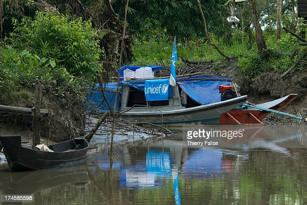 UNICEF boat is anchored near a village on a small tributary of the Irrawaddy River According to official figures the cyclone killed about 140000...