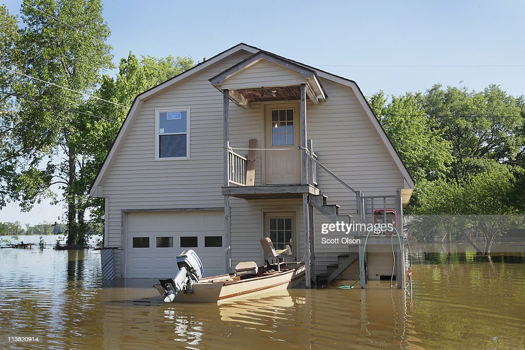 A boat is docked at the steps of a home which is surrounded by floodwater May 6, 2011 near Finley, Tennessee. Heavy rains have left the ground saturated, rivers swollen, and have caused widespread flooding in Missouri, Illinois, Kentucky, Tennessee, and Arkansas.