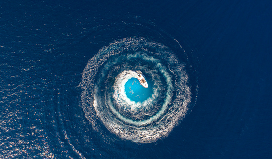 A boat is driving in a circle and produces a big whirlpool 1043003600