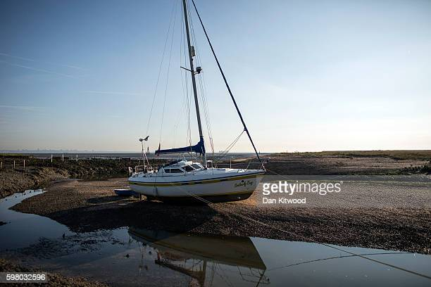 A boat is moored in a creek on the Isle of Grain on August 31 2016 in Isle of Grain England The Isle of Grain is the easternmost point of the Hoo...