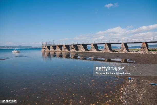 A boat is not able to dock at the pier because of the low water level of Bracciano lake on July 28 2017 in Rome Italy Bracciano lake is an important...