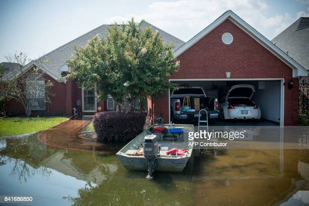 A boat is parked outside a flooded home in Port Arthur Texas on Thursday September 1 2017 Stormweary residents of Houston and other Texas cities...