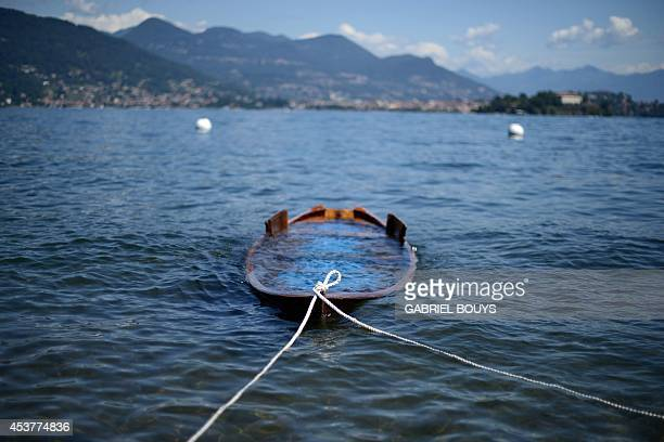 A boat is pictured at Lake Maggiore near Stresa on August 18 2014 Lake Maggiore is a large lake located on the south side of the Alps It is the...