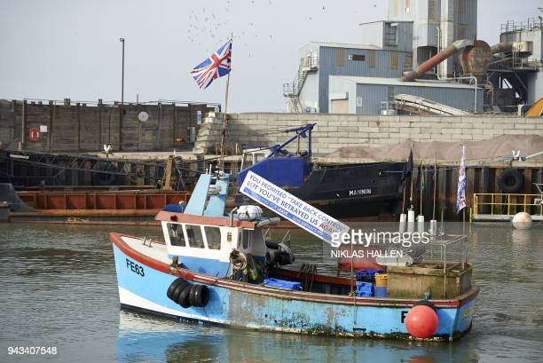 A boat is pictured in the harbour during a demonstration in Whitstable southeast England on April 8 2018 against the Brexit transition deal that...