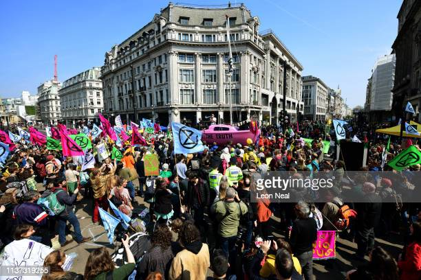 A boat is placed in the centre of the traffic junction as Environmental campaigners block Oxford Circus during a coordinated protest by the...
