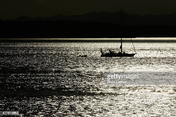 A boat is seen in the Puget Sound during the second round of the 115th US Open Championship at Chambers Bay on June 19 2015 in University Place...