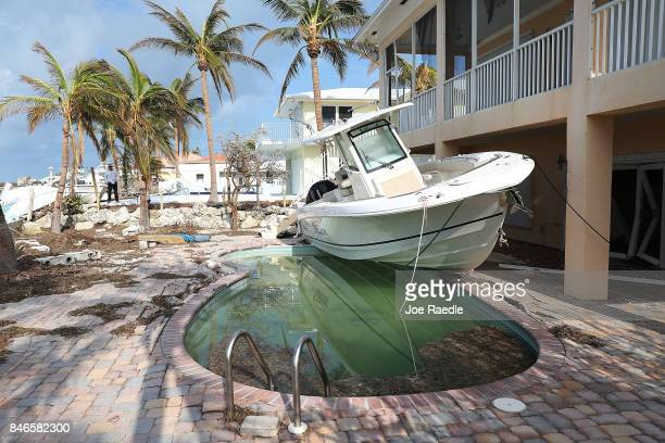 A boat is seen next to a home after Hurricane Irma passed through the area on September 13 2017 in Duck Key Florida The Florida Key's took the brunt...