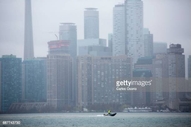 TORONTO ON MAY 5 A boat is seen on Lake Ontario from Wards Island Toronto Mayor John Tory visited the Wards Island to see the flooding efforts and...