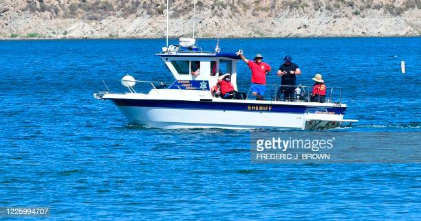 A boat is seen on Lake Piru in the Los Padres National Forest Ventura County California on July 9 2020 as the search continues for actress Naya...