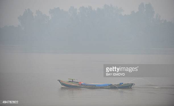 A boat is seen on the Kapuas river in Kuala Kapuas in central Kalimantan on October 29 2015 before clearing later in the day Rain and favourable...