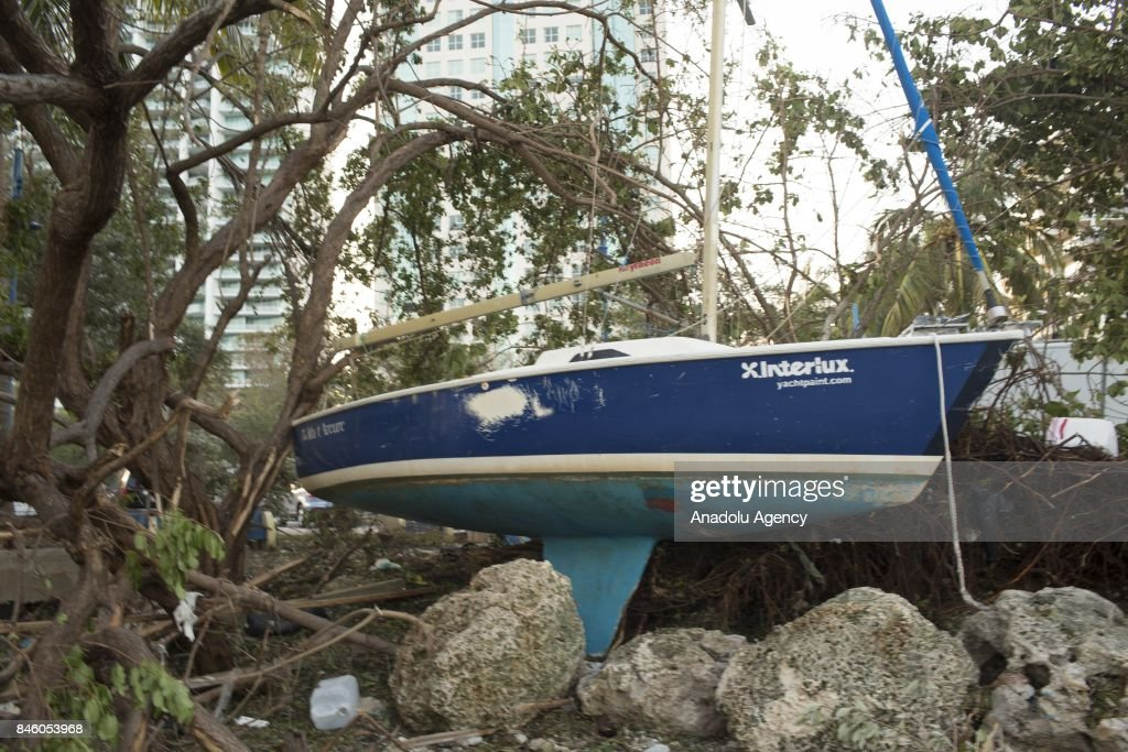A boat is seen swept up from the water onto ashore after Hurricane Irma at the Prime Marina Miami in the Coconut Grove neighborhood in Miami, Florida, USA on September 12, 2017.