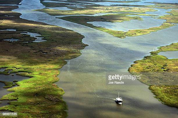 A boat is seen underway in the marshland in the southwest region of Louisiana as the government tries to protect the coastline from the massive oil...