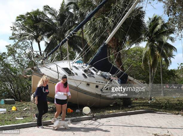 A boat is seen washed ashore at the Dinner Key marina after hurricane Irma passed through the area on September 11 2017 in Miami Florida Florida took...