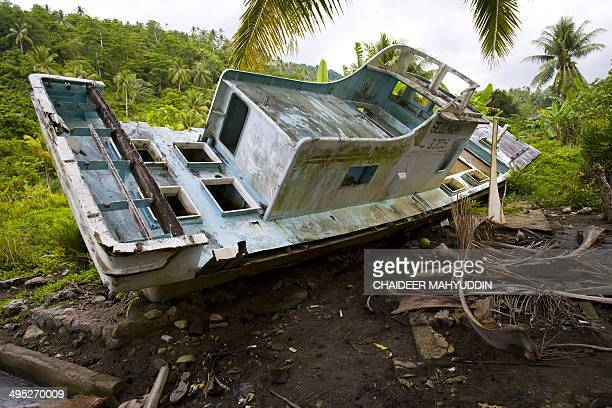 A boat is washed ashore during the 2004 tsunami Tsunami in Mustika Kolam Bermata Village Sabang island on October 17 2008 AFP PHOTO/Chaideer Mahyuddin