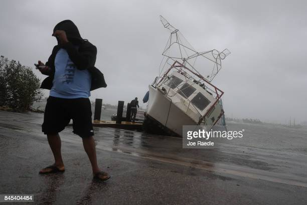 A boat is washed on shore at the Watson Island marina as Hurricane Irma passed through the area on September 10 2017 in Miami Florida Hurricane Irma...