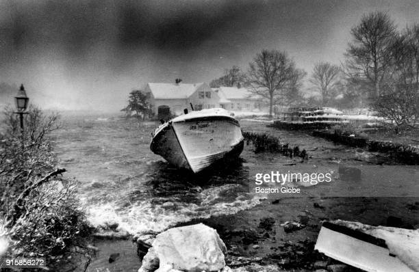A boat is washed up into Doliber's Cove in Marblehead Mass on Feb 7 following the Blizzard of 78