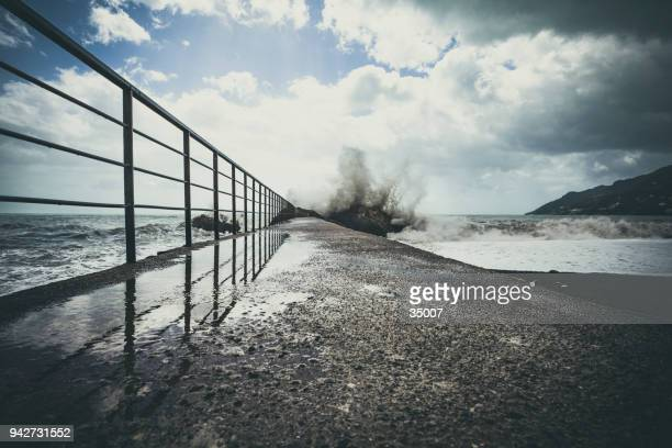 boat jetty with splashing waves, amalfi coast, italy - quayside stock pictures, royalty-free photos & images