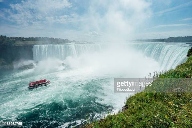 boat journey at niagara horseshoe falls - niagara river stock pictures, royalty-free photos & images
