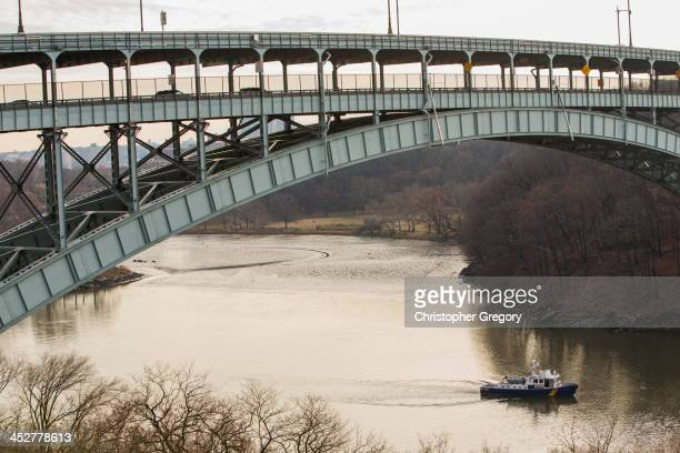 NYPD boat just under the Henry Hudson Bridge near the site of a MetroNorth commuter after it derailed just north of the Spuyten Duyvil station...