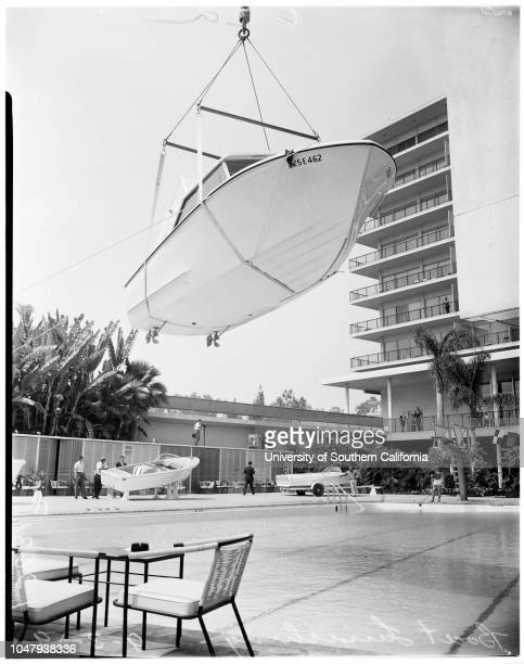 Boat launching at Beverly Hilton pool 2 September 1959 25 foot boat launching by 80' craneCaption slip reads 'Photographer Monteverde Date 25' boat...