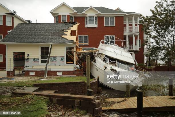 A boat lays smashed against a car garage deposited there by the high winds and storm surge from Hurricane Florence along the Neuse River September 15...
