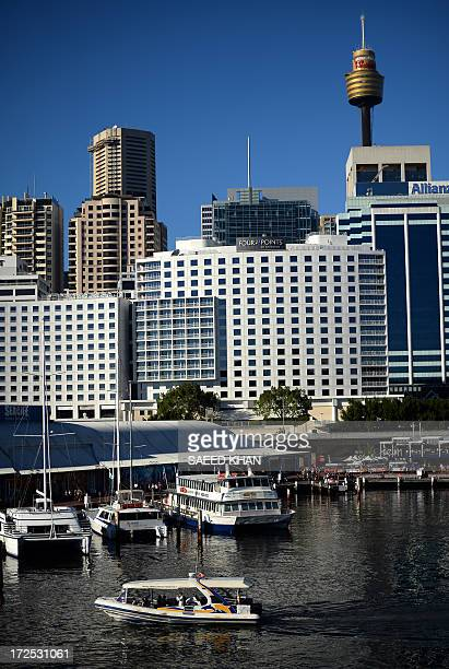 A boat leaves Sydney's Darling Harbour on July 3 2013 Australia's central bank held the official interest rate steady at 275 percent with an uptick...