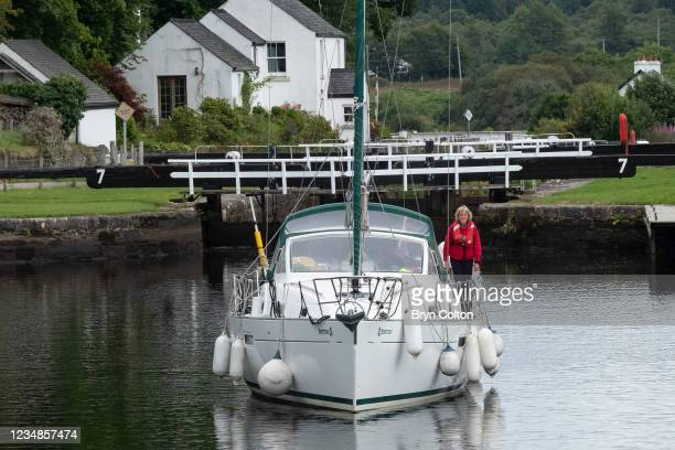 Boat leaves the sea locks at gate seven on the Crinan Canal on August 19, 2021 in Cairnbaan, Scotland. Passage along the canal has been reduced as...