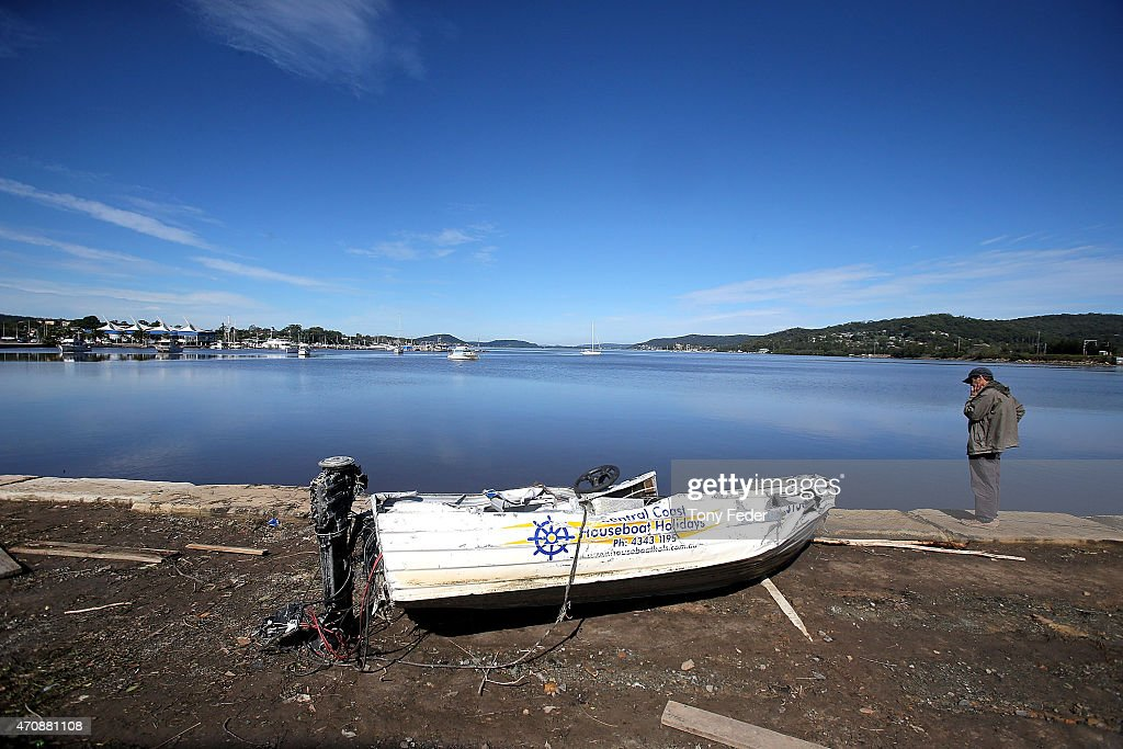 A boat lies on the banks of the Gosford waterfront on April 24, 2015 in Gosford, Australia. Gosford City and Wyong shire have official been declared disaster zones, due to the damage caused by the worst storms to hit the region in decades.