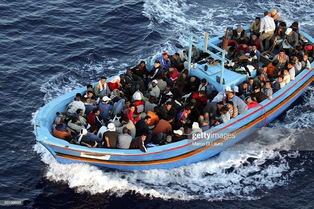 Italian Border Patrols Pick Up Boatloads Of Illegal Immigrants : News Photo